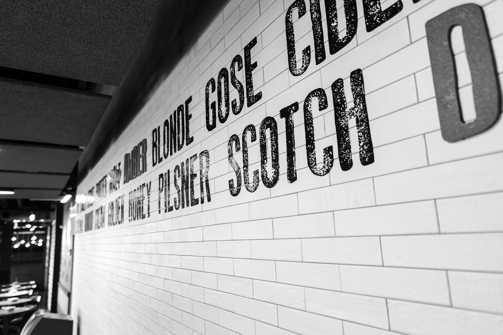 Close up of the graphic wall application of beer types shown in a black and white image