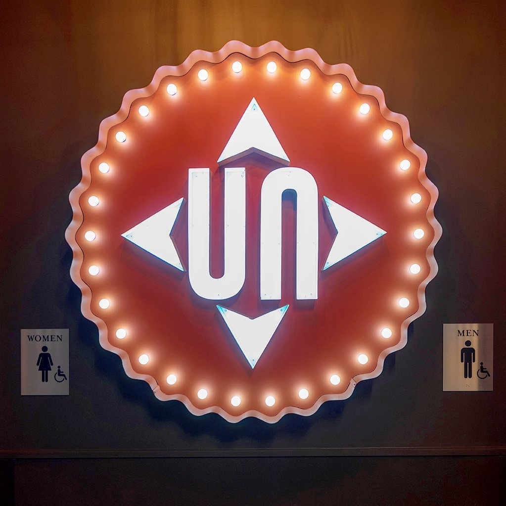 Illuminated marquee style sign with the Up North logo