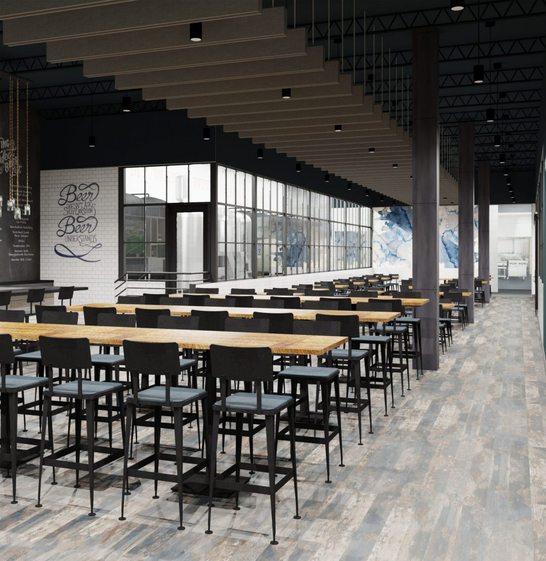 "The dining area features industrial metal chairs with upholstered seats and distressed wood table tops. The brewing room can be seen through large glass windows adjacent to the seating. On the back wall is blue and white a watercolor mural and closer to the bar is a blue wall graphic on white subway tile that reads ""Beer doesn't ask questions, beer understands"""