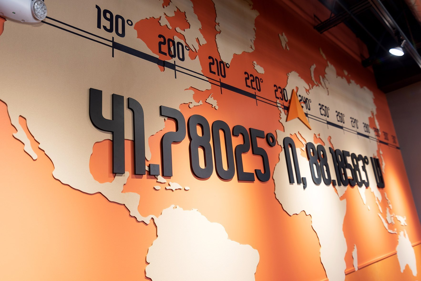 Close up of the orange map wall showing the dimensional wall graphic applications