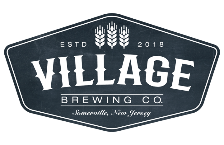 "An oblong hexagonal badge style logo for Village Brewing Company with a navy distressed background and white lettering that reads ""Village Brewing Co. Somerville, New Jersey"" with ""estd. 2018"" at the top with three wheat stocks in the center"