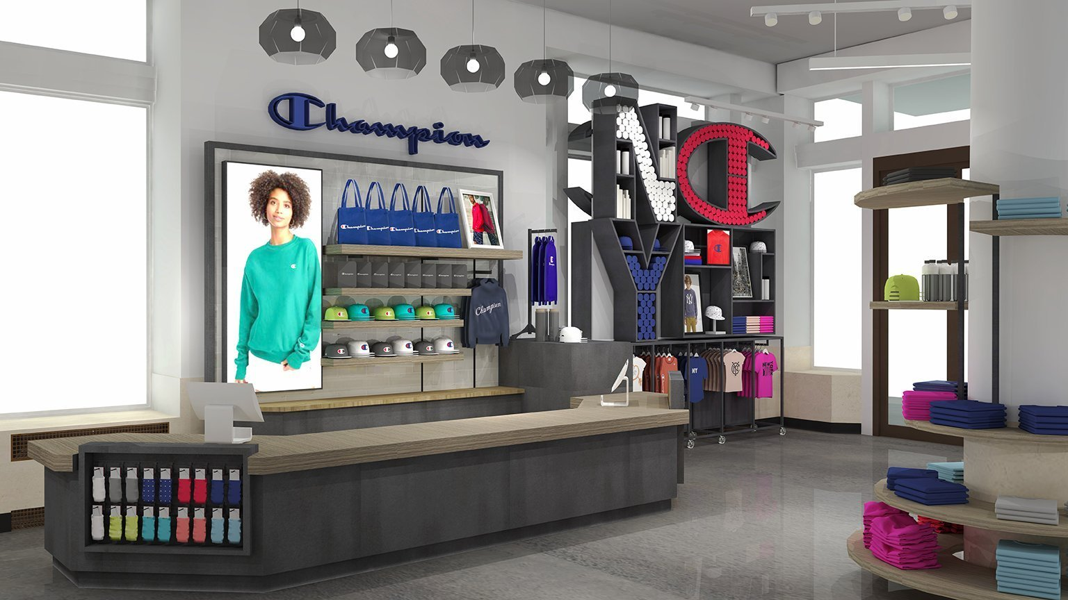 """This custom cash wrap in the shape of the letter """"C"""" for Champion features a light toned wood counter top with metal base and a custom merchandise display on the wall behind. A large custom merchandise display in the shape of the letters """"NYC"""" stands between the cash wrap and the entrance, holding merchandise within the letters and the surrounding shelving."""