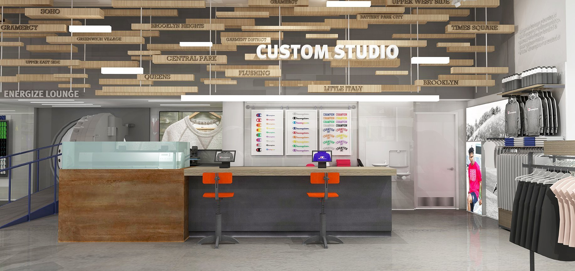 The Customization Studio at the back of the store allows customers to add patches to their merchandise. The multi-layered wood feature overhead features the names of NY boroughs. There is seating in front of the bar with digital displays for customers to choose their designs.