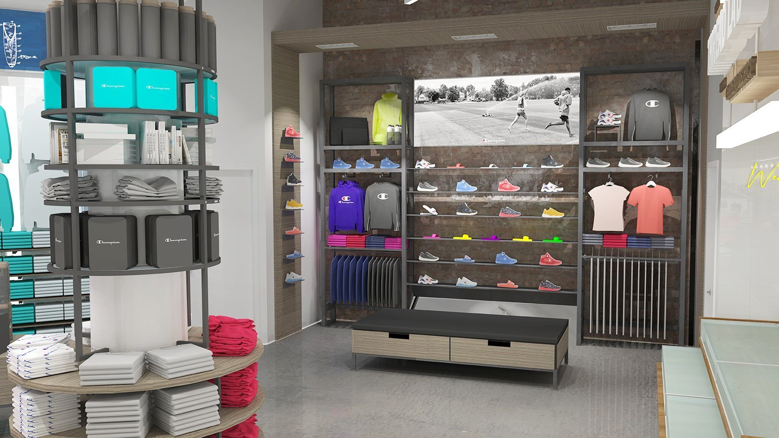 The footwear wall also features an illuminated graphic and more general apparel on a metal framed retail fixture against a distressed brick wall.